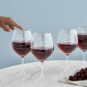 a finger touching major scale wine glass